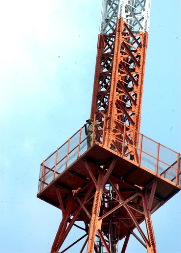 Home Guard Srinivas Naiks climbs atop the AIR tower in Hyderabad