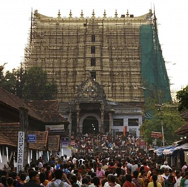 Devotees throng to Sree Padmanabhaswamy temple after offering prayers on the eve of Pongala
