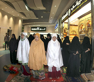 Women pray in a shopping centre at the Zamzam Tower next to the Grand Mosque in Mecca