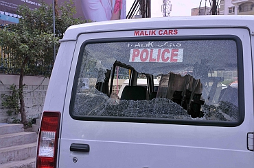 A police vehicle damaged by Telangana supporrters
