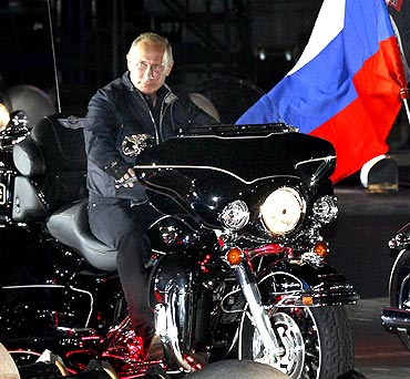 Vladimir Putin during his visit to a bike festival.
