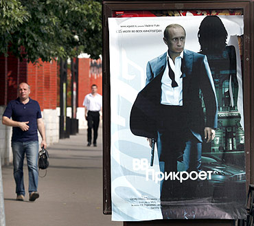 A poster of Vladimir Putin posing as a spy in Moscow