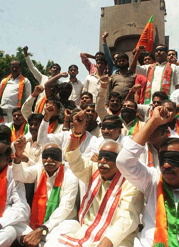 BJP leaders and activists protest against government's 'dilly dallying' over Telangana in Hyderabad on Friday