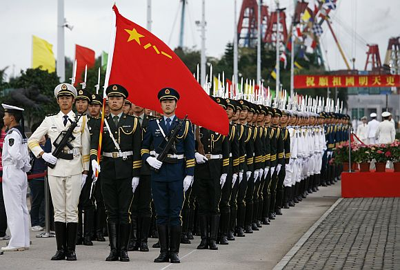 Chinese People's Liberation Army soldiers take part in a parade