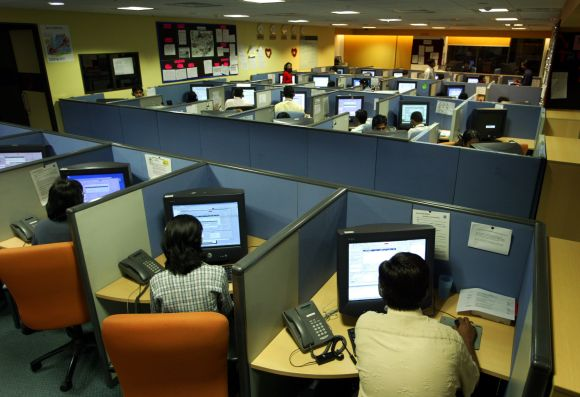 Indian employees at a call centre provide service support to international customers in Bangalore