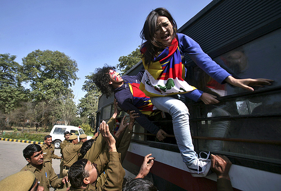 Tibetan exiles are detained by the police during a protest in front of the Chinese embassy in New Delhi