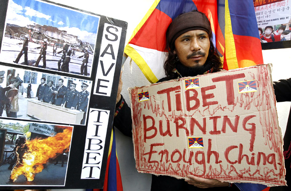 A Tibetan resident takes part in a Free Tibet demonstration, denouncing the Chinese government in front of the Chinese embassy in Seoul