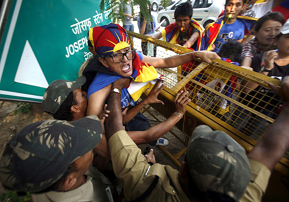 A Tibetan exile is detained by the police during a protest in front of the United Nations Information Centre in New Delhi
