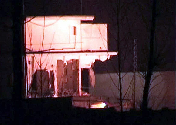 Demolition work is carried out of the building where Aal Qaeda leader Osama bin Laden was killed by US Special Forces