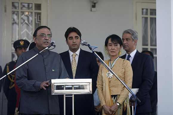 Pakistani President Zardari speaks to reporters after presenting Myanmar pro-democracy leader Suu Kyi with the Benazir Bhutto Shaheed Award for Democracy in Yangon