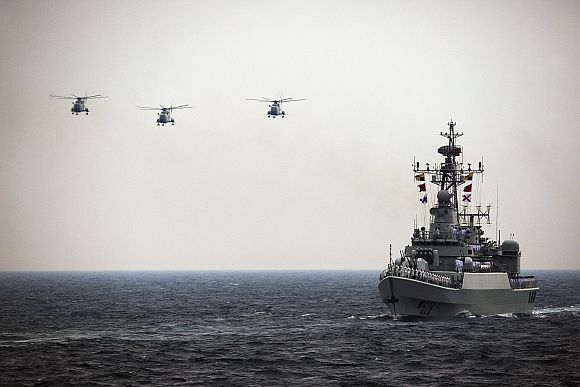 Helicopters accompany the Chinese Jiangwei II naval frigate