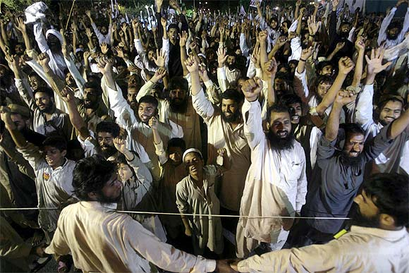 JuD activists shout anti-Indian slogans during a rally in Islamabad