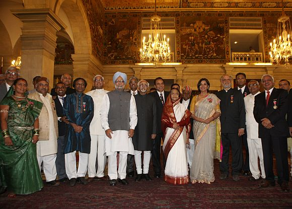 President Pratibha Devisingh Patil, Vice President Hamid Ansari and Prime Minister Manmohan Singh with the Padma Awardees