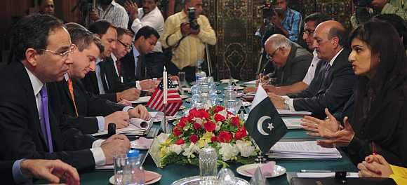 US Deputy Secretary of State Thomas R Nides and Pakistan's Foreign Minister Hina Rabbani Khar talk with their delegations during a meeting at the foreign ministry in Islamabad