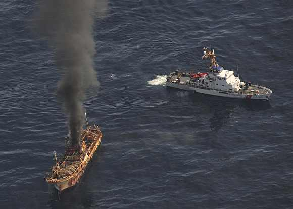 Ryou-Un Maru burns after US coast guard fired explosive ammunition at the vessel