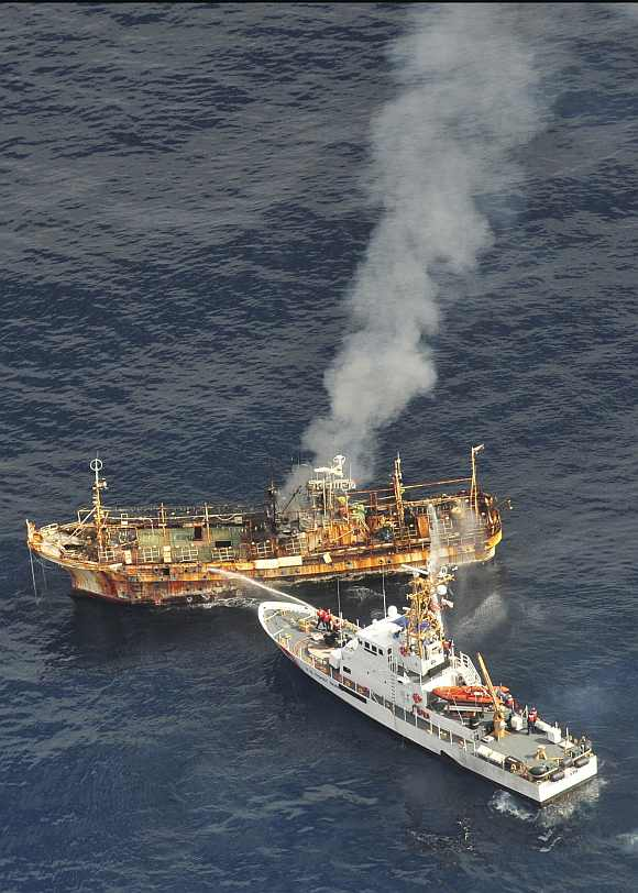 US Coast Guard Cutter Anacapa crew douses the adrift Japanese vessel with water after a gunnery exercise