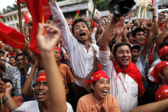 NLD supporters celebrate its good showing in the recent elections.