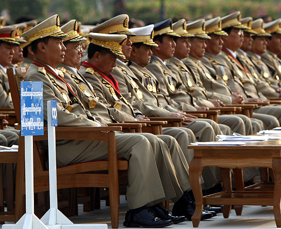 From left to right: Former generals Thura Shwe Man and Thein Sein with other military officers watch a marchpast during the 2010 Armed Forces Day ceremony.