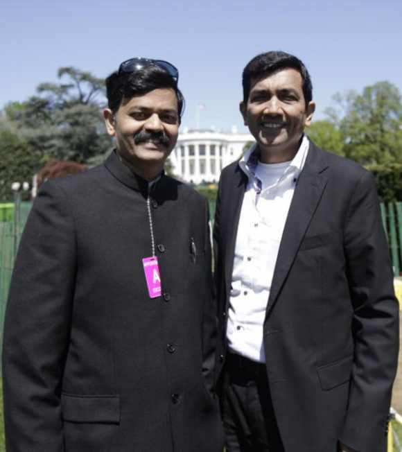 The two chefs pose outside the White House