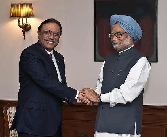 Prime Minister Manmohan Singh with Pakistan President Asif Ali Zardari during a meeting in New Delhi on April 8, 2012