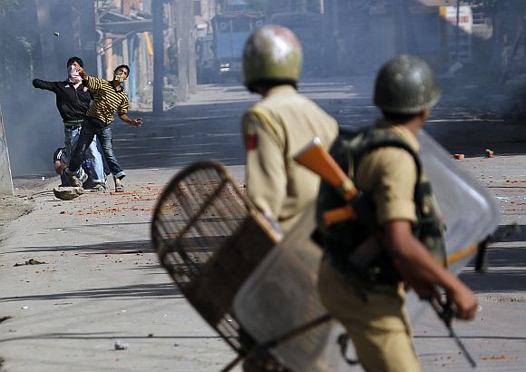File image of Kashmiri protesters throwing stones at police during a clash in Srinagar
