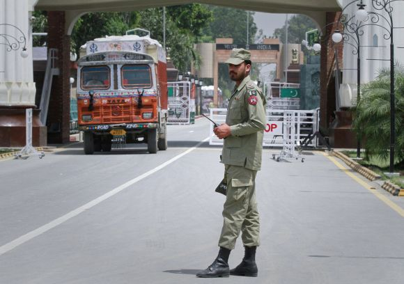 A Pakistani soldier stands guard at the Wagah border separating India and Pakistan