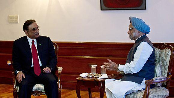 Prime Minister Manmohan Singh with Pakistan President Asif Ali Zardari during a meeting in New Delhi on April 8, 2012
