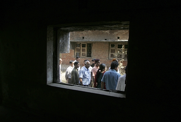 Survivors of the 2002 Gujarat riots are pictured at the Gulbarg Society in Ahmedabad