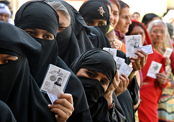 Voters outside a polling station in Ayodhya.