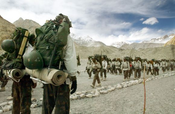 Indian soldiers muster at the base camp after coming back from training at Siachen Glacier