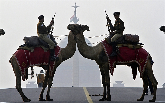 Border Security Force soldiers ride their camels in front of India's presidential palace Rashtrapati Bhavan during a rehearsal for the