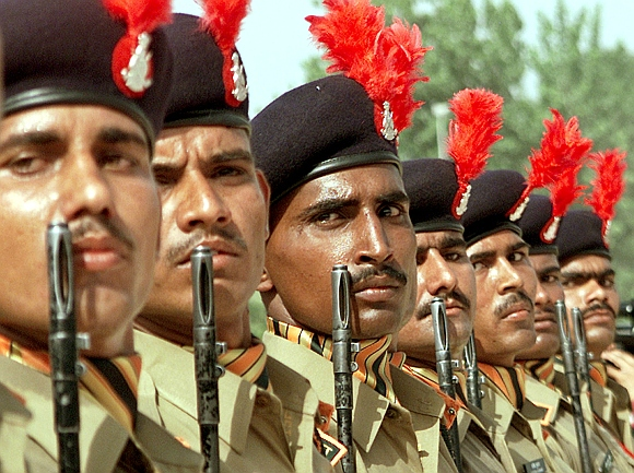 New recruits of the Indo-Tibetan Border Police attend their induction parade at a camp in Amritsar