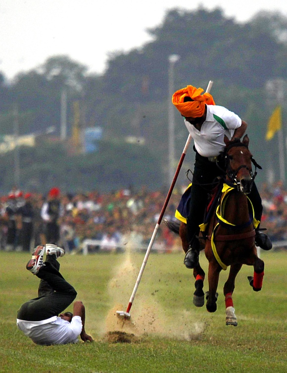 Army soldiers perform an equestrian stunt ahead of the Vijay Diwas celebrations in Kolkata