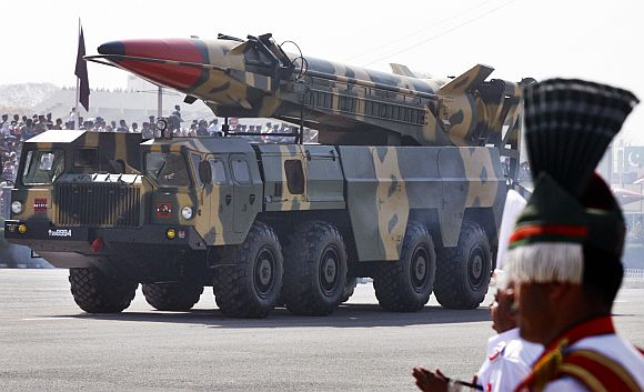 Nuclear-capable missile Shaheen II is driven past with its launcher during Pakistan National Day parade in Islamabad