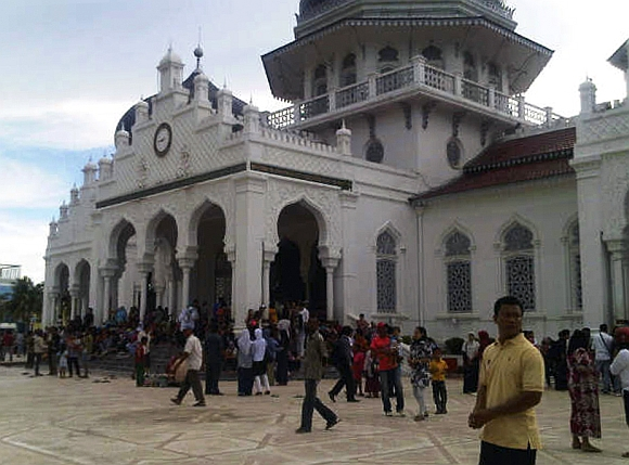 People gather outside the Baiturrahman mosque after an earthquake hit Banda Aceh in Indonesia