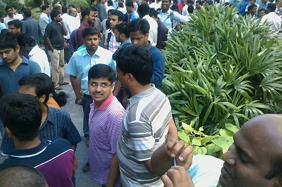 People rushed out of their offices after the tremors, in Chennai