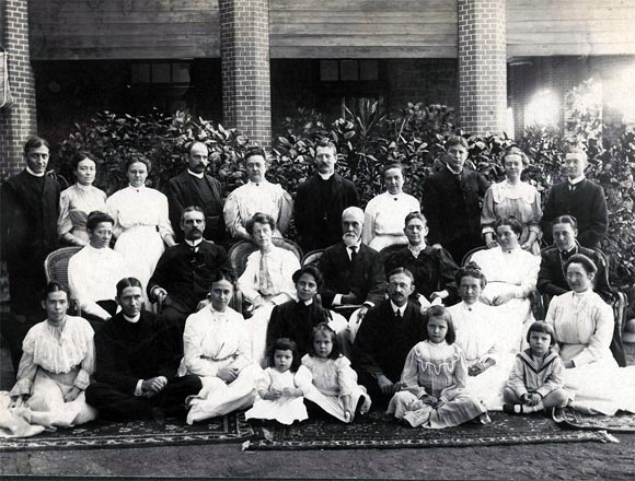 Ruth Becker, sitting, the third child from right, with missionaries in Guntur. Back, her parents Allen Becker, furthest left, and Nellie Becker, third from left