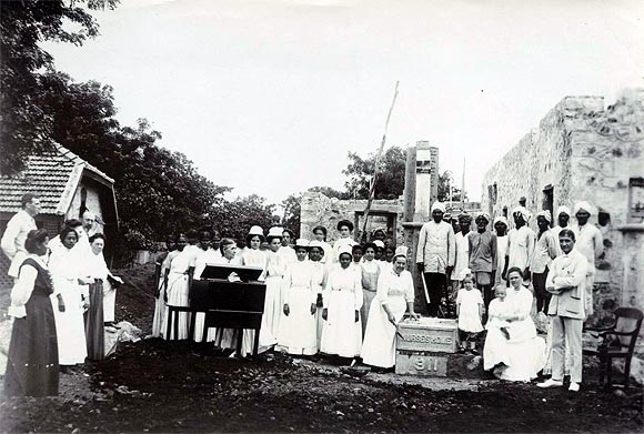 Mr and Mrs Allen Becker (far right) at the ground-breaking ceremony in Guntur with Marion, 4, and Richard, 1