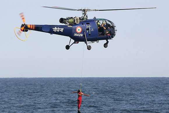 Indian Navy's Chetak helicopter demonstrates a rescue operation