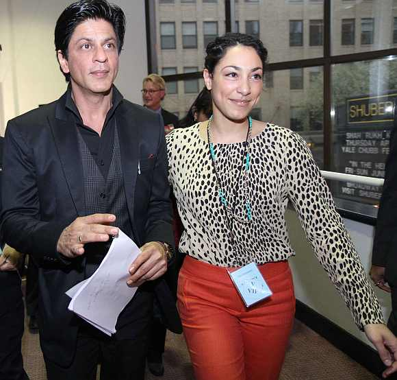 Bollywood actor Shah Rukh Khan is being escorted to the Yale University on Friday