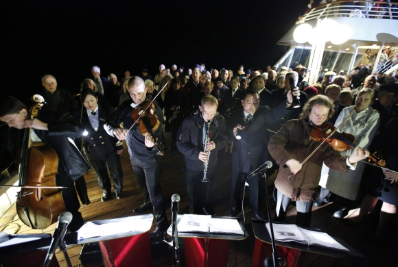 Belgian quintet Grupetto perform during a service of remembrance aboard the Titanic Memorial Cruise