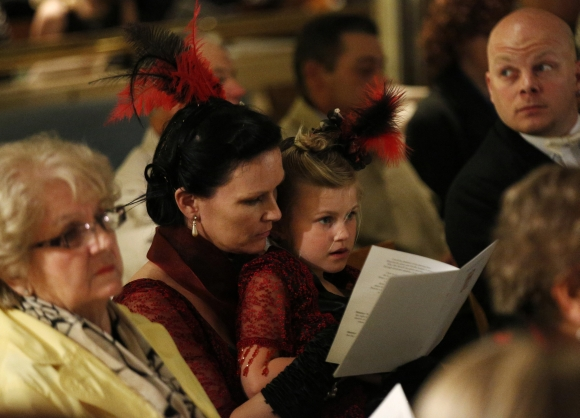 Jaki Free  of Manchester sings hymns with her daughter Rosie, 5, during a religious service of remembrance aboard the Titanic Memorial Cruise