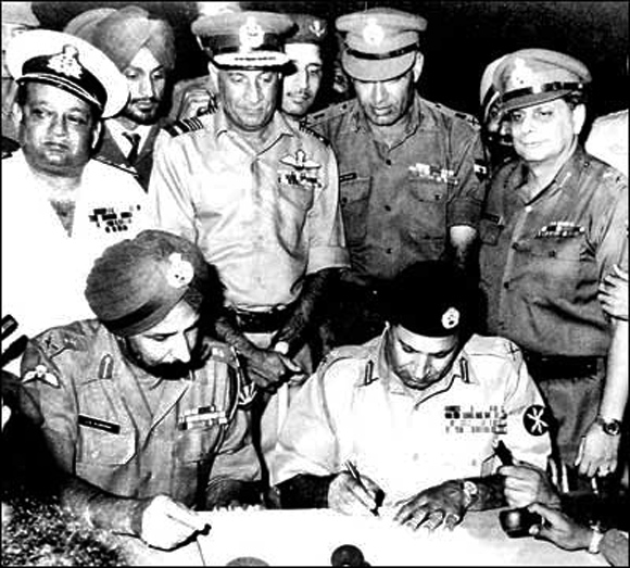 December 16, 1971: Pakistani Lieutenant General A A K Niazi signs the Instrument of Surrender in the presence of General Officer Commanding in Chief of India and Bangladesh forces in the Eastern Theatre, Lieutenant General Jagjit Singh Aurora