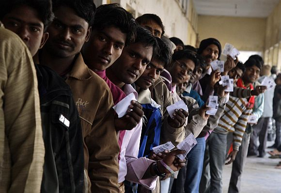 Voters at a polling station during the second phase of UP elections, in Gorakhpur
