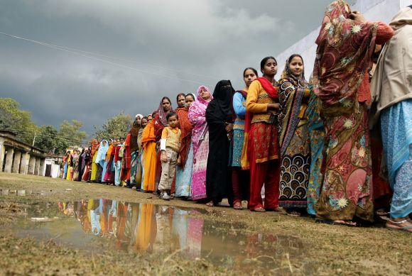 Women voters line up to their cast in Haraiya town of UP