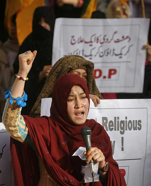 A member of the minority Shi'ite Hazara Democratic Party chants slogans during a demonstration against recent violence in Quetta