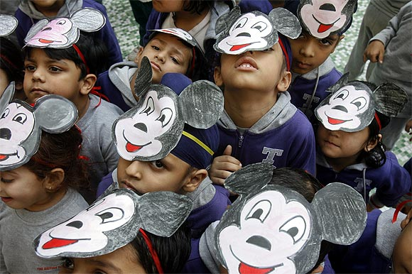School students pose for pictures during an event