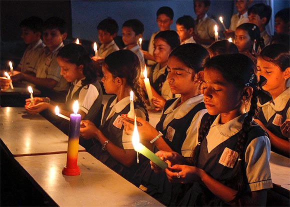 Students attend a candlelight prayer ceremony