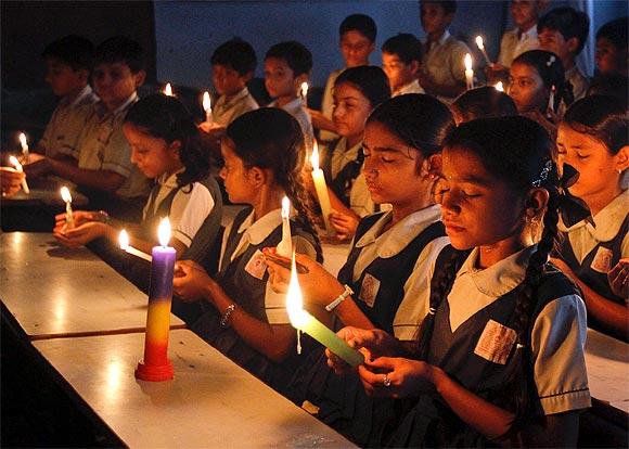 Students attend a candlelight prayer ceremony