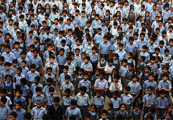 -School children attend a prayer memorial